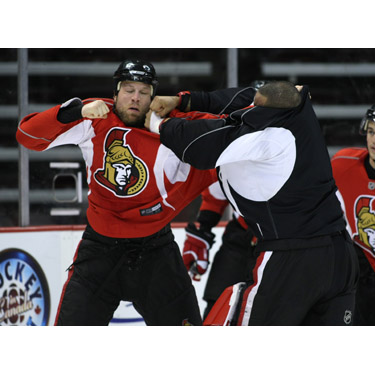 Brian McGrattan and Ray Emery fight during an Ottawa Senator's practice in 2008.