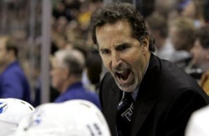 Tampa Bay Lightning head coach John Tortorella yells at his players during the final minutes of their 3-2 win over the Minnesota Wild in an NHL hockey game in St. Paul, Minn., Thursday, Jan. 4, 2007.  (AP Photo/Ann Heisenfelt)