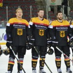 The German players listen to the national anthem after their win vs Japan. Photo Credit: Jelena Levsina/IIHF